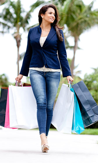 happy outlet mall shopper with shopping bags